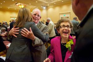 Jennifer Rhoads congratulates Bob and Sally Schaefer during First Citizen 2013