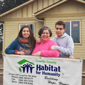 Family portrait in front of Cowlitz County Habitat for Humanity home